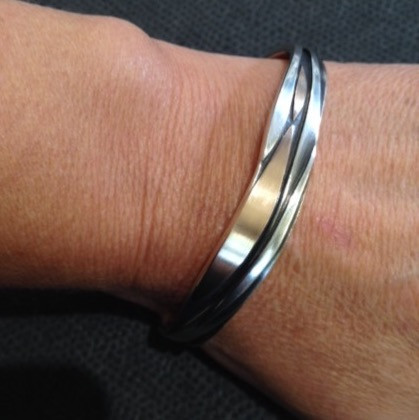 Sterling silver and 18ct rose gold cuff.  £325  Layers of Sterling silver and 18ct rose gold on an oxidised silver background.  Christine Savage 07966550936