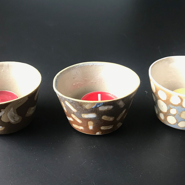 Tealights porcelain or stoneware, various designs £12 / £14 Please email or text Siglint Kessler 07730871780
