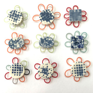 Broach,  porcelain and rubber, £29 Please email or text Siglint Kessler 07730871780