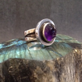 Oval Amethyst ring.  £220  An oval Amehyst cabouchon in a Sterling silver, rubover setting mounted on a layered, oxidised silver shank.   Size Q.  Christine Savage 07966550936