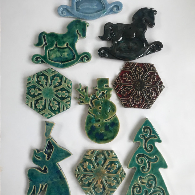 Najha Saleh Christmas Magnets £15 each, or two for £25 Stoneware Clay, Glazed. Smallest size: approx. 8cm x 8cm Largest size: approx. 12cm x 6cm Various colours available in each design.