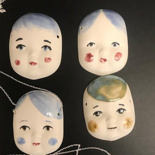 Doll face pendant Porcelain with silver necklace, £25