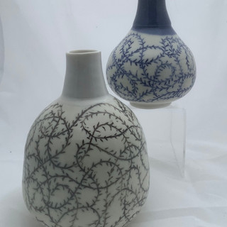 Brambles: two carved bottles