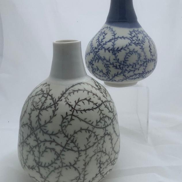 Brambles: two carved bottles