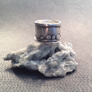Wide, riverbed ring  £98  Oxidising and layering of the Sterling silver create this stylised riverbed scape. 16mm wide.  Size to order.  Christine Savage 07966550936