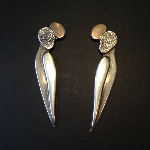 Wasp earrings  £190  Sterling silver and rose gold earrings, layered, textured and oxidised surfaces create these stylised wasp earrings. 43mm long.  Christine Savage 07966550936