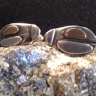 Beetle cufflinks.  £130  Oxidised and layered Sterling silver, with 9ct rose gold. 25mm x 14mm.  Christine Savage 07966550936
