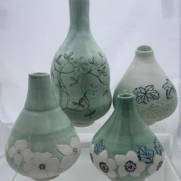 Four porcelain bottles
