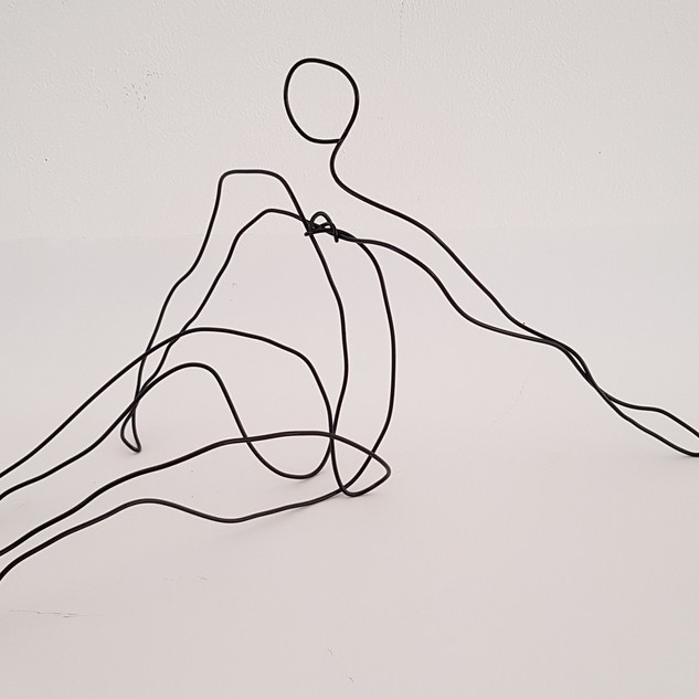 Wire figure seated Wire, black spray paint, spray varnish,  55cm(h) x 28cm(w) x 30cm(d), £70 Nicki Rolls