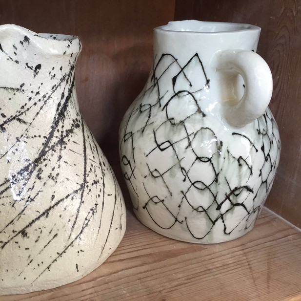 Earthenware vases by Oka Ward