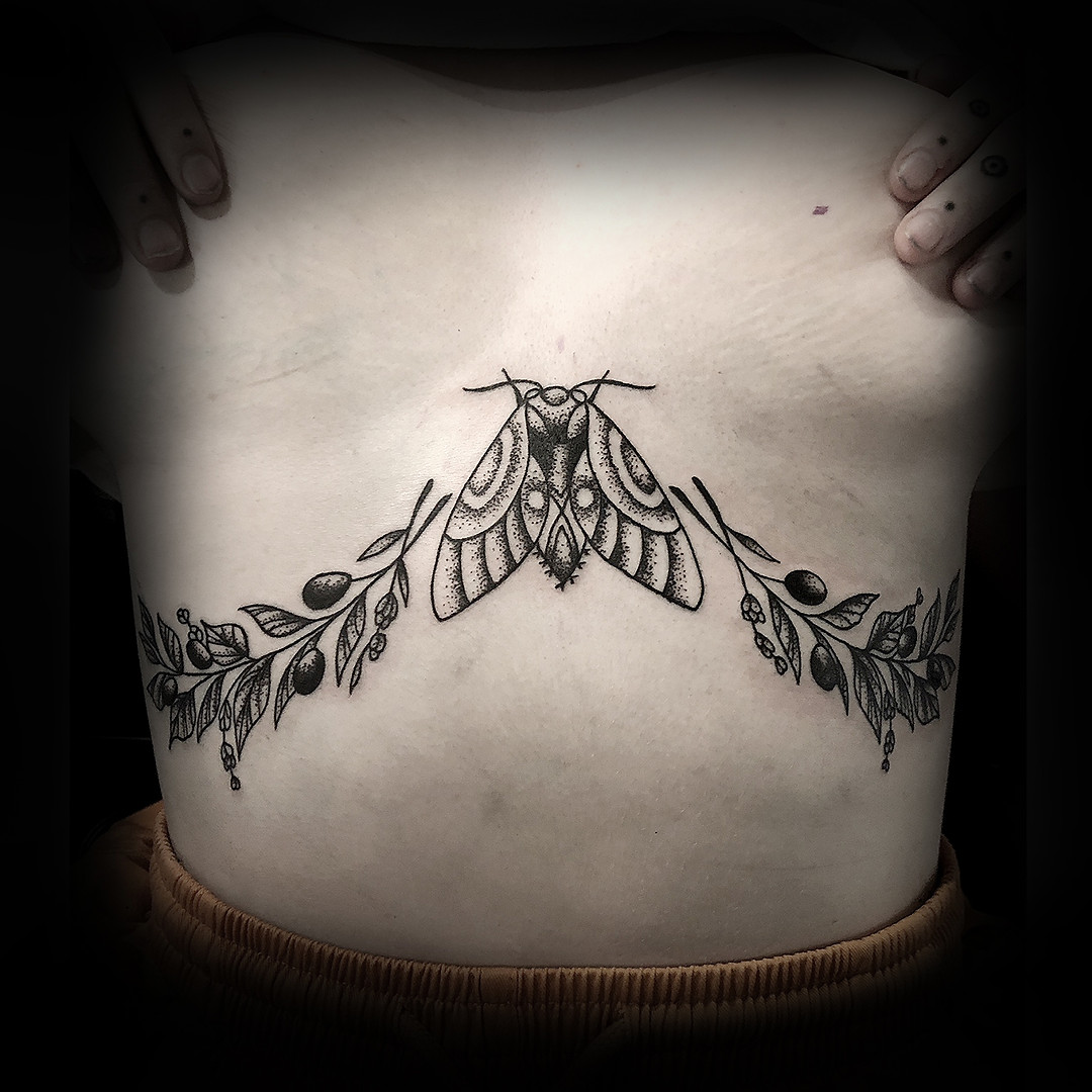 Olive branch with Moth on Una's sternum 18'