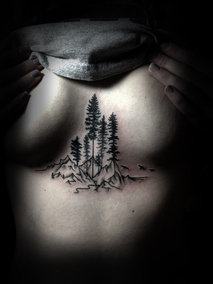 Pine trees and mountains for Hannah's sternum 18'