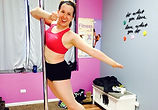 pole dance and fitness student in pole class