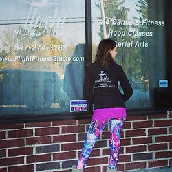 michelle heller flight fitness studio owner and instructor outside storefront
