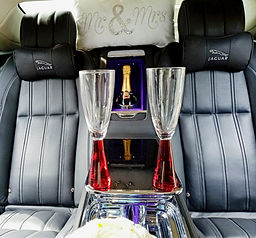 Luxury wedding car hire with champagne.j