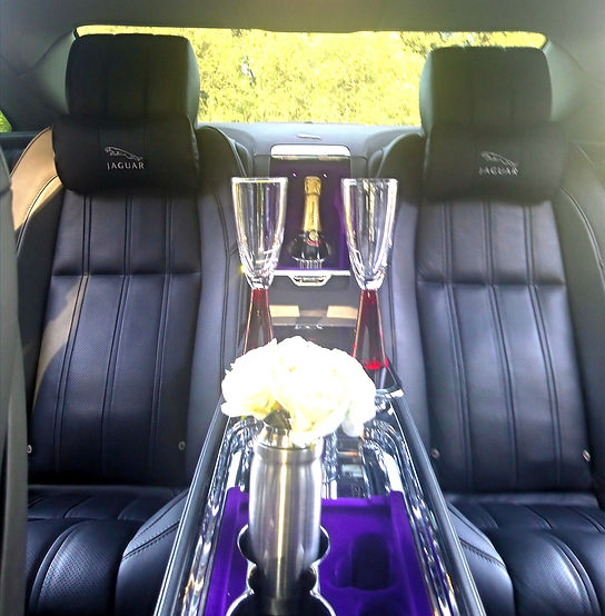 Jaguar wedding car hire with champagne