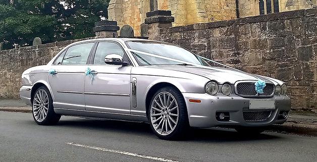 Blue trim Jaguar XJL wedding car service from Sheffield