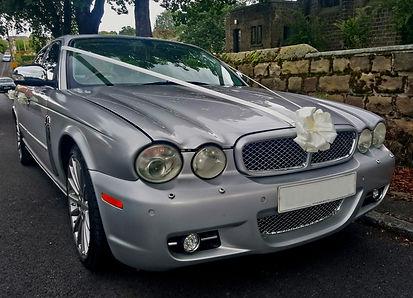 Jaguar XJL silver wedding car hire with