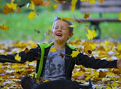 happy-boy-and-autumn-leaves-1477493103B4
