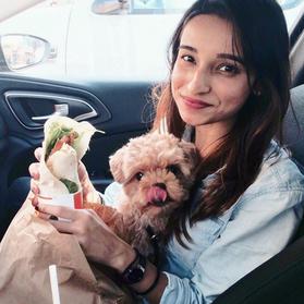 Photograph of illustrator and artist Farhana Hossain, aka Dewmanna with her puppy dog, maltipoo Whisky