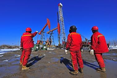 Wellsite supervisors observing field operatons