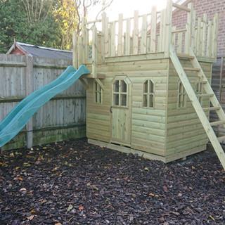 Wooden-Castle-with-Slide