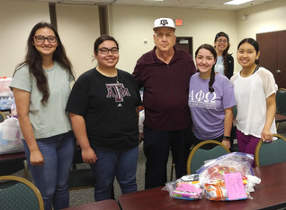 STUDENTS GIFT CUSTODIANS WITH GOODY BAGS