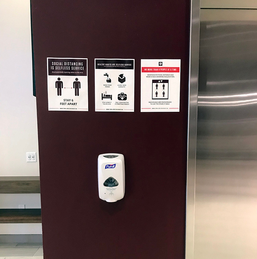 elevator signs and sanitizer