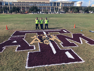 GROUNDS PAINTS LOGO ON SIMPSON DRILL FIELD