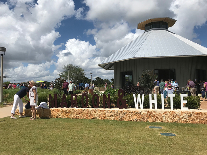 grand opening - maroon and white outside pavilion