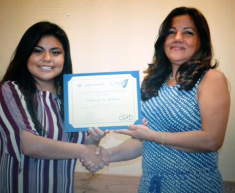 Blanca Macareno (L) presents  Carmen Mulske (R) Community Health Worker Certification