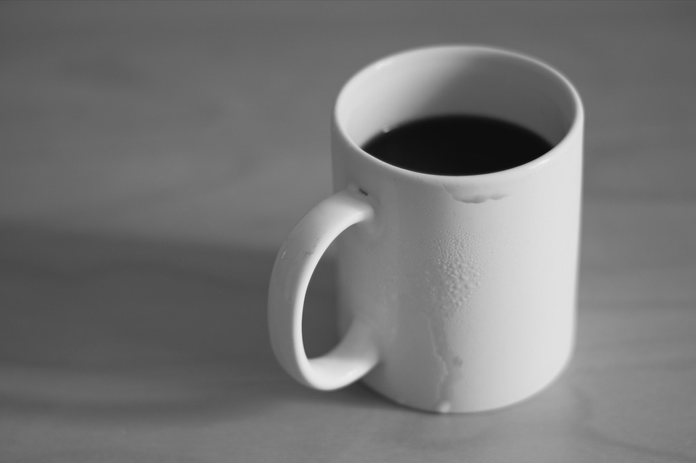 minimalist black and white coffee cup