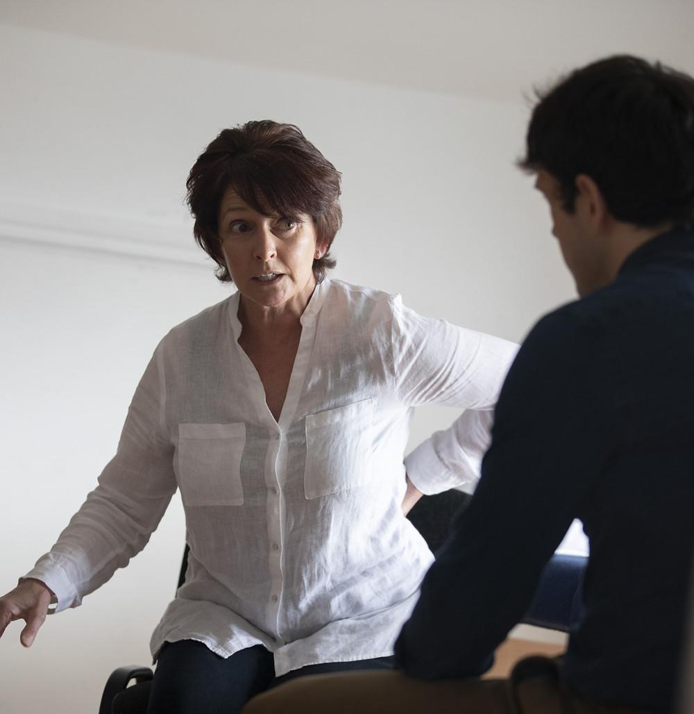 Woman explaining she has back pain.