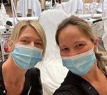 2 students wearing masks on clinic floor_edited.jpg