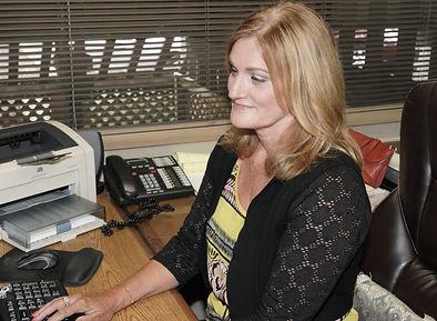 Darlene at desk.jpg