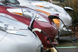 Electric Cars recharging at a charging station