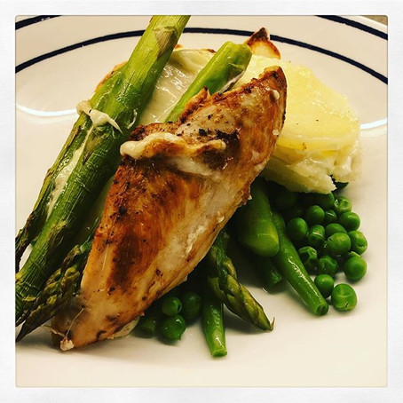 Oven baked mozzarella and asparagus stuffed chicken with dauphinoise potatoes and greens