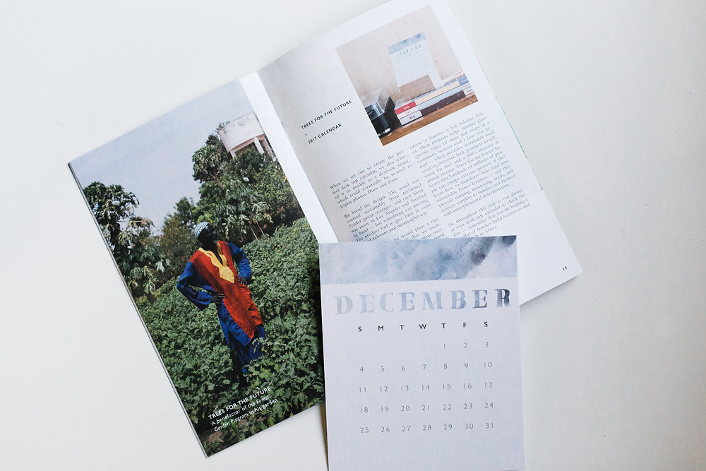 2017 Desk Calendar, with woodblock stand handmade in Los Angeles from reclaimed wood. For every calendar that CAUSEBOX creates, a tree is planted by way of our charity partner: Trees for the Future.