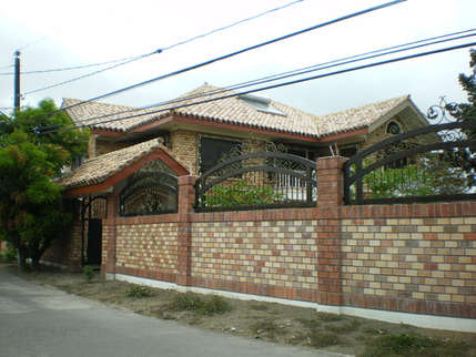 Chua's Cape Cod-inspired Brick Two-story Residential House
