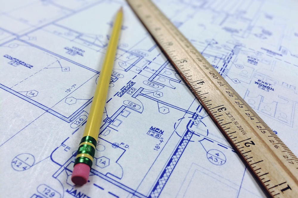 Achitect plans with ruler and pencil in Advento Builders blog