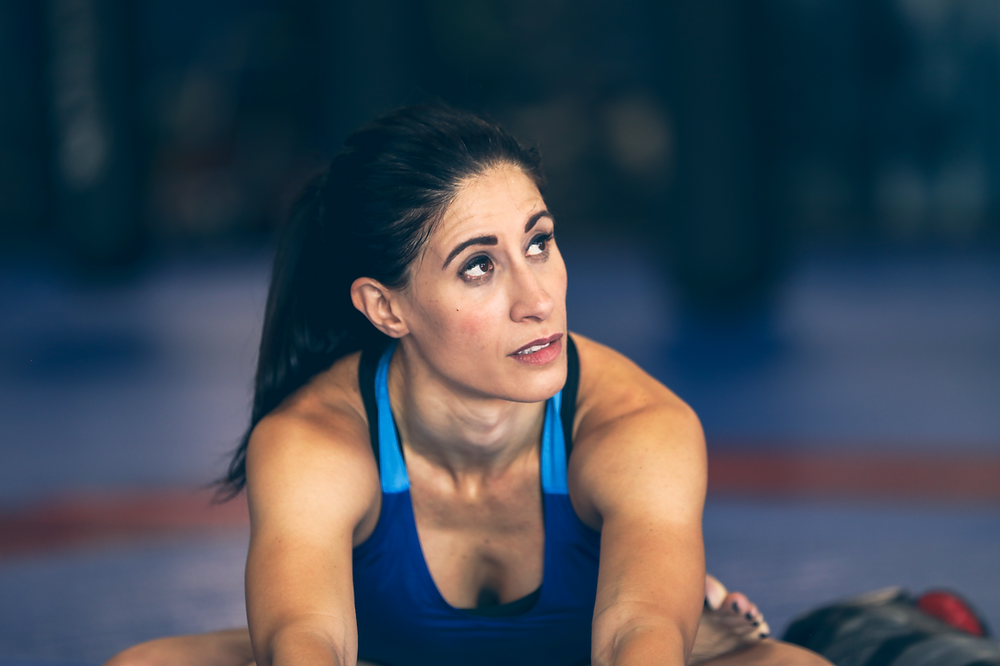 Laura stretching during training at her MMA gym in Scottsdale, Arizona