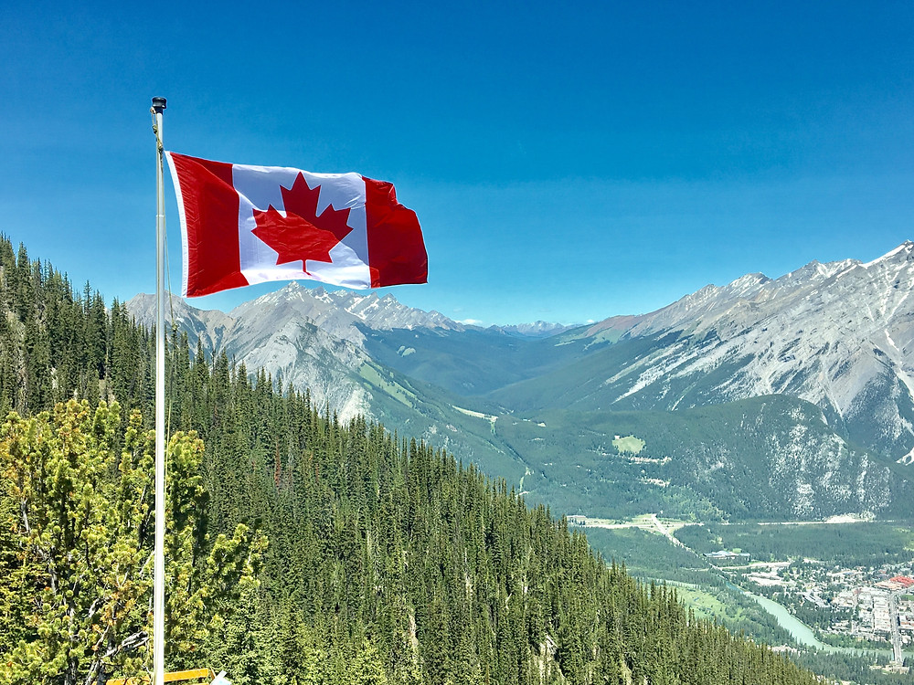 Canadian flag flies over the Rockies