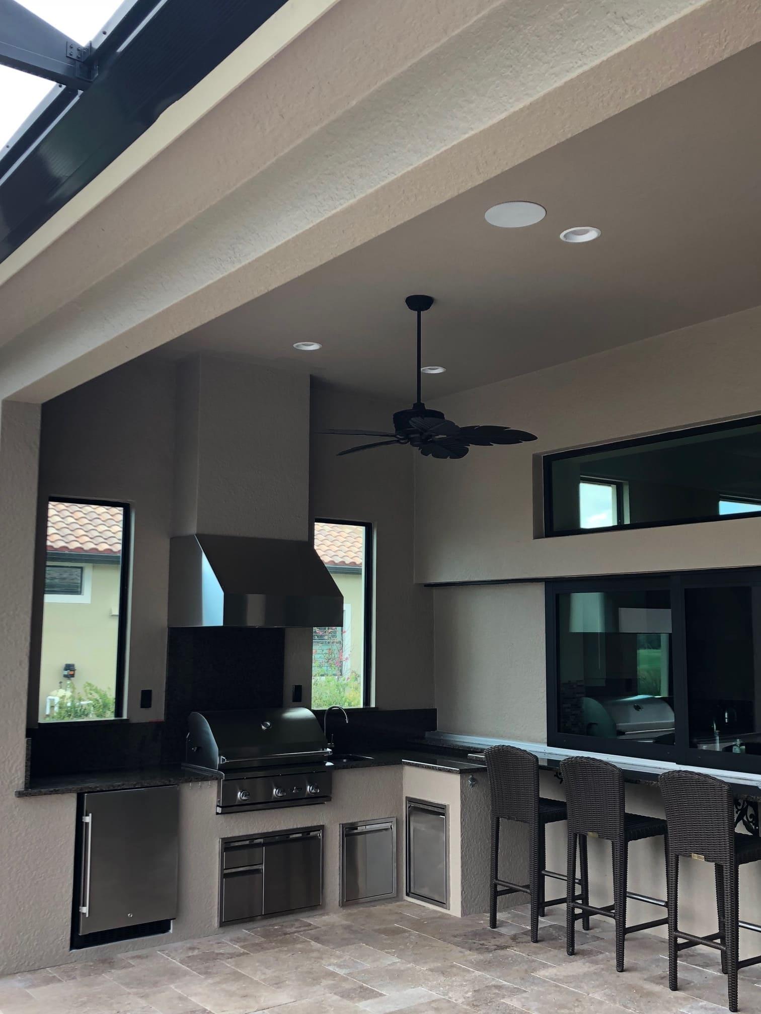 tan stucco outdoor kitchen