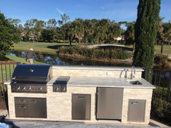 off-white stone outdoor kitchen