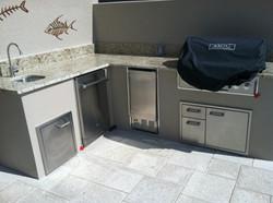 grey stucco outdoor kitchen