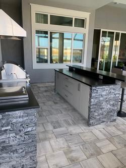 grey stone outdoor kitchen