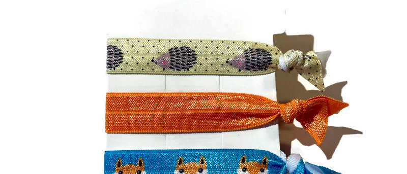 yellow hedgehog / orange / fox hair / wrist bands
