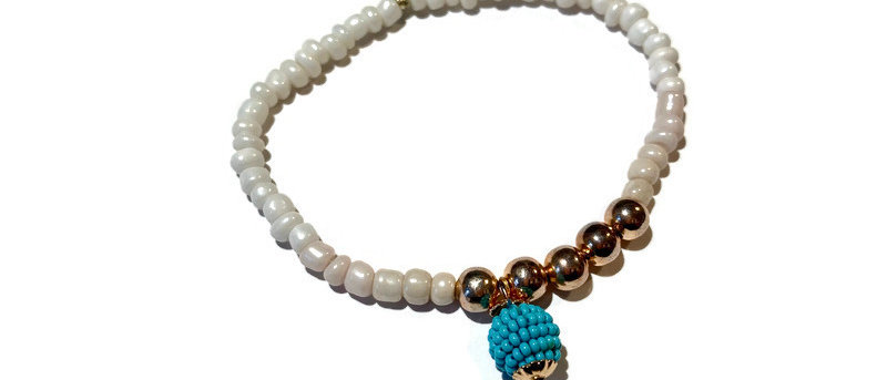 white / gold / turquoise dangle bead bracelet