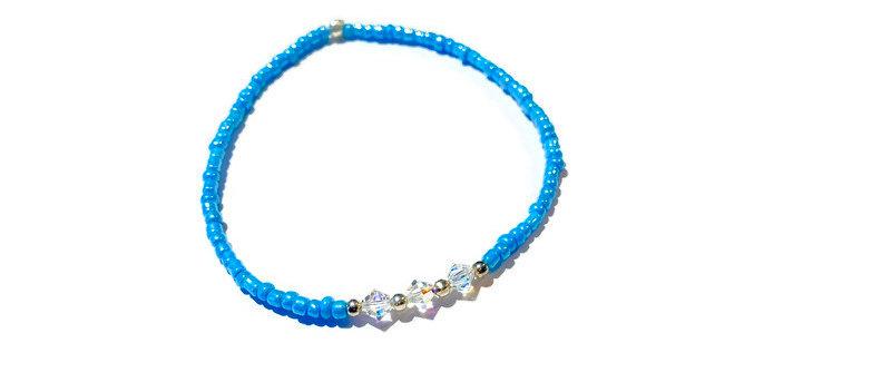 blue bead bracelet featuring Swarovski clear crystals
