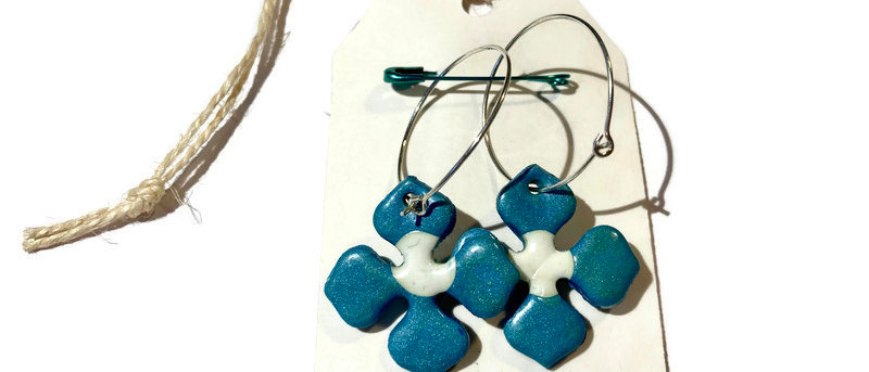 teal and white flower clay earrings